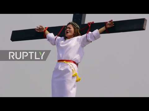Catholic devotees 'crucify' and lash themselves in Passion re-enactment *GRAPHIC*