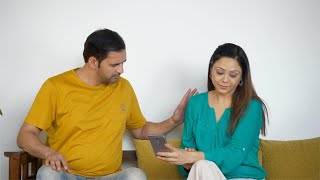 Indian married couple discussing their monthly expenditures - a family lifestyle