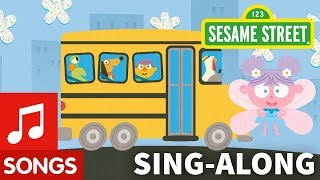 Sesame Street: Wheels on the Bus with Lyrics | Elmo's Sing-Along