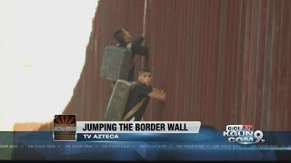 Two Men Caught On Camera Hopping The Border Fence