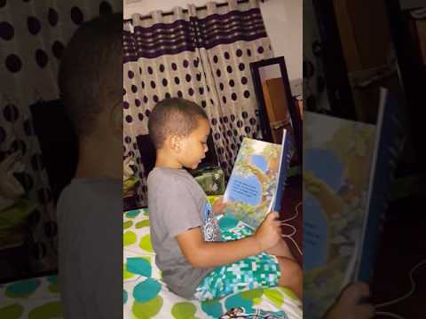 Caleb Foster attempting to read