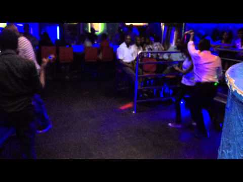 Karaoke night at club signature kisumu backed up by salsa dancers