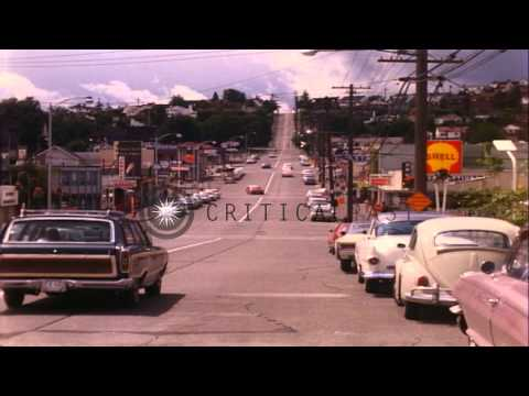 Cars pass by a street in Seattle, Washington HD Stock Footage