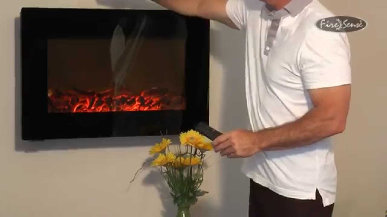 black wall mounted electric fireplace instructional video item