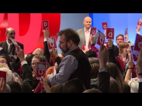 Germany's SPD backs formal coalition talks with Merkel