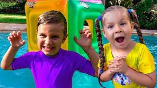 Diana e Roma brincam com brinquedos infláveis divertidos