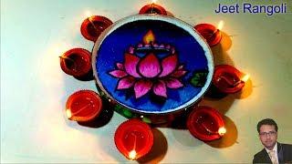 Diwali special rangoli on water surface. Lotus rangoli on water.