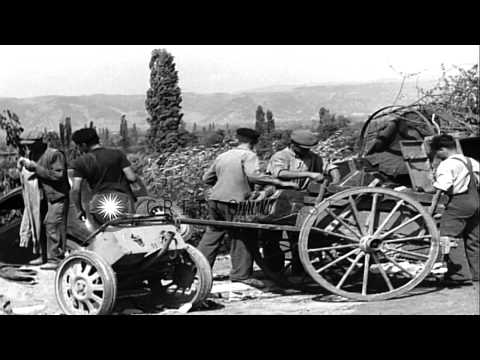 Wrecked German equipment and dead German soldiers in Loriol, France. HD Stock Footage