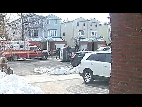 EMS rushes to flipped SUV on Staten Island