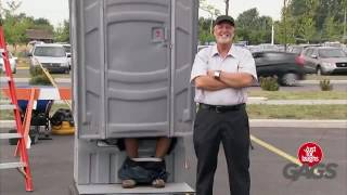 Porta Potty Lifted Up With Visitor Inside