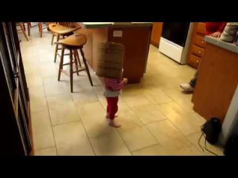 2 year old puts a basket on her head and pretends to be a monster, try not to laugh