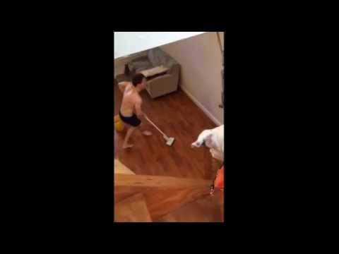 A man is caught cleaning the floor while dancing on a song
