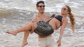 Mariah Carey and Dancer Bryan Tanaka Share Steamy Kiss on the Beach