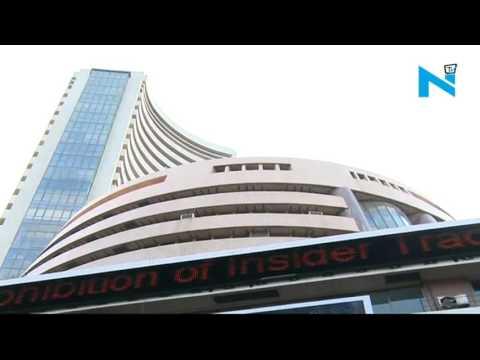 Sensex edges lower, Infosys falls 3% on lower guidance