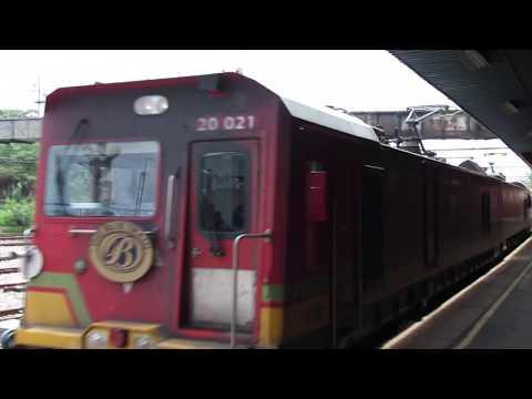 Short Blue Train arriving at Pretoria station.