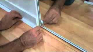 How To Lay A Laminate Wood Floor: Installing Trim Near A Closet Door