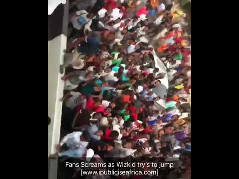 Fans Scream As Wizkid Tries To Jump Off From A High Hill Van (Video)