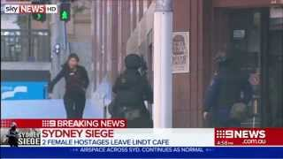 Two Woman Flee Sydney Cafe Hostage Siege