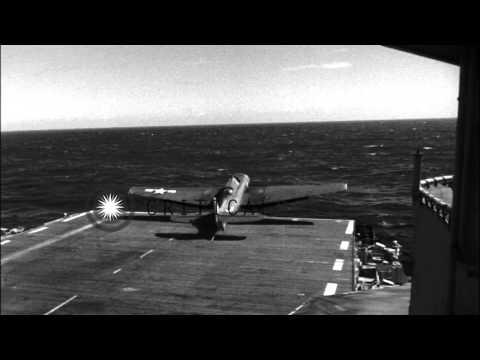 Navy Grumman F4F aircraft in landing incidents on USS Makassar Strait (CVE-91) du...HD Stock Footage