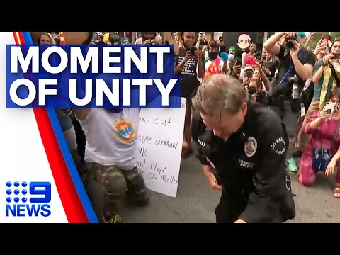 Senior LA police officer kneels with protesters | 9 News Australia