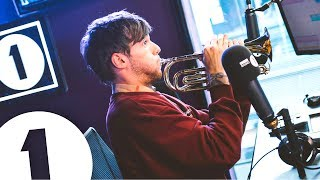 louis-tomlinson-plays-trumpet-and-talks-tobey-maguire-niall-and-pel