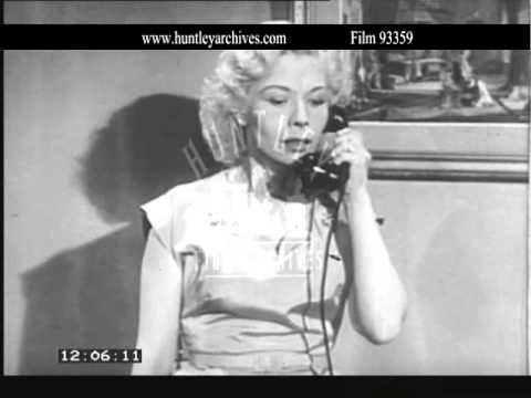 Woman answers phone and gets bad news.  Archive film 93359