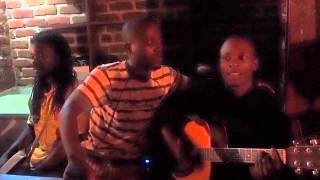Malawian Poem to Acoustic Guitar