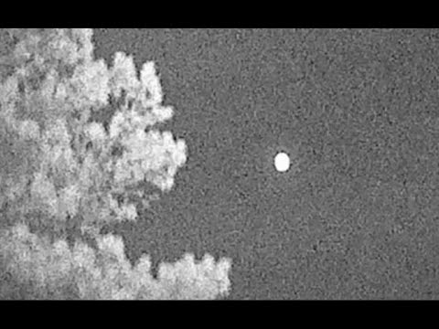 Hunter Catches Bright Hovering Sphere On Mountain In Wyoming.
