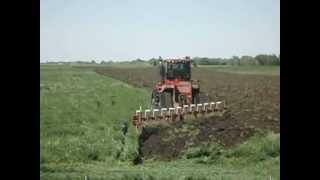 Steiger 600 quad & 12 bottom plow SD