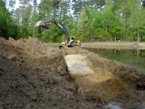 Excavator digging pond youtube for Digging a koi pond