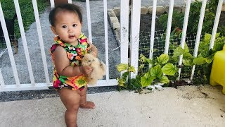 baby-girl-catch-baby-chick-baby-11-months-catch-chick-home-chicken-playwithadon