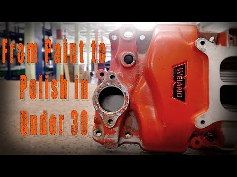 The fast way to restore and clean off paint and polish off of a Chevy Manifold is Vapor Blasting.