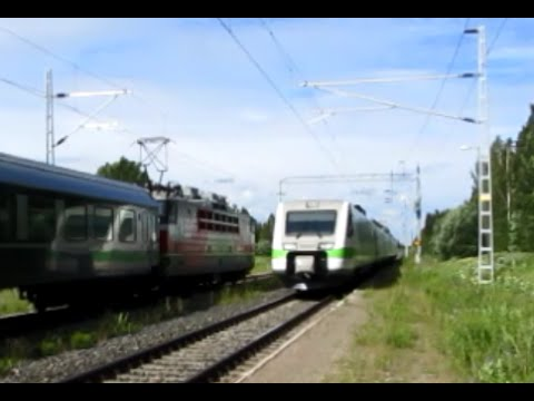 Finland: VR Class Sr1 electric loco and Sm3 Pendolino passenger services pass at Tervola station