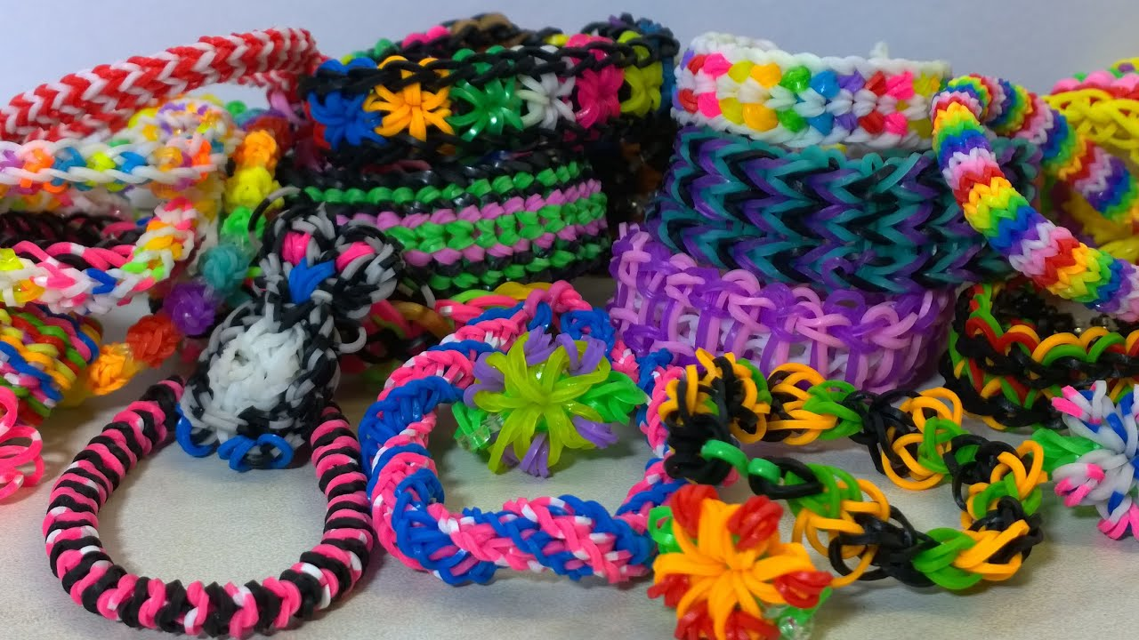 for of rainbow rubber bracelets stock hands photo and colorful the making table color round loom on pile small bands
