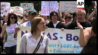"""Holding signs and chanting """"We love sluts!"""" approximately 2,000 protesters marched Saturday in Bosto"""