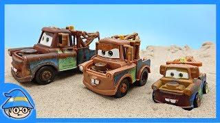 Three Tow truck toys of Disney Cars meet the Lightning McQueen. Racing Lightning McQueen.