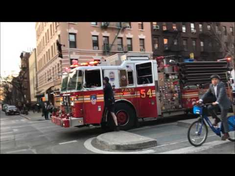FDNY ON SCENE OF SMOKING MANHOLE GRATE ON WEST 47TH STREET IN HELL'S KITCHEN, MANHATTAN, NEW YORK.