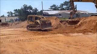 cat d4d dozer pushing clay