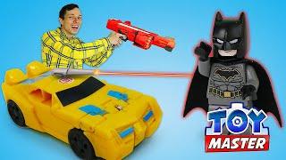 Игры стрелялки с Трансформерами –Автобот Бамблби против Бэтмена! – Новое видео шоу Той Мастер.