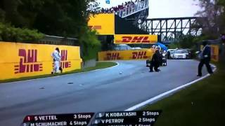 F1 Marshall falls over trying to pick up debris