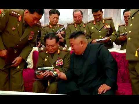 Kim Jong Un Gives Commemorative Pistols on  Officers of DPRK Armed Forces