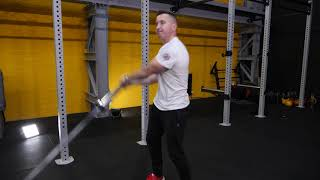 Fixed barbell standing Russian twists