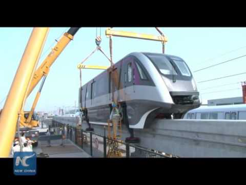 China unveils first permanent magnet straddle-type monorail train