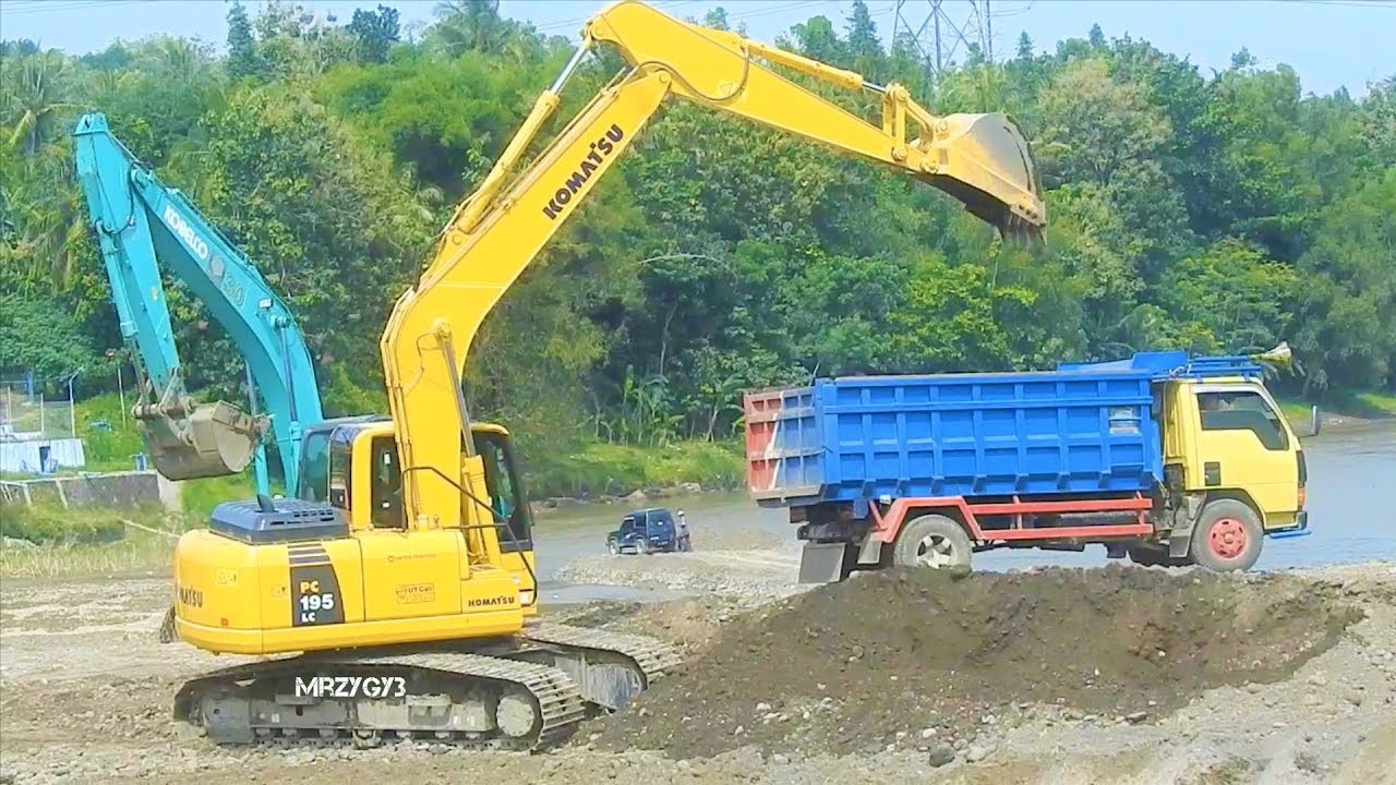 Excavator Working On Dam Construction Komatsu PC195LC PC200 Kobelco SK200  Sumitomo SH210