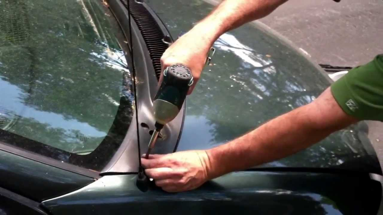 how to clean a clogged windshield drain