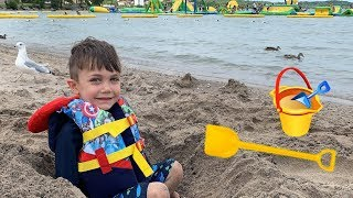 Playing in the Sand on the beach with toys - Family Fun Video