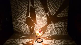 Handmade Butterfly gourd lamp by Calabarte and moving shadows .