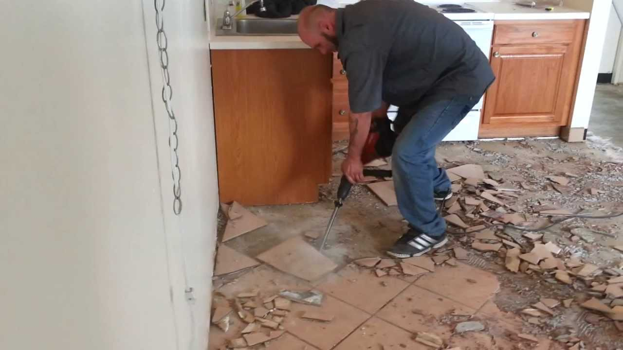 Demolishing and removing flooring tiles youtube demolishing and removing flooring tiles dailygadgetfo Images