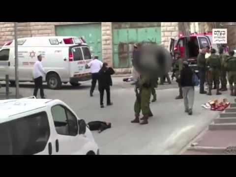 Soldier fires at the head of downed terrorist (Media Resource Group)