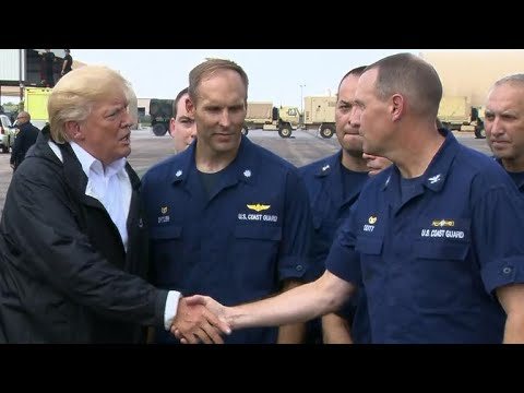 Trump greets rescue crews before heading to Louisiana